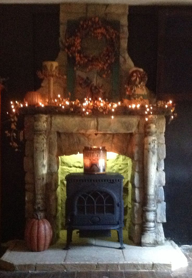 Stone fireplace with wood burning stove.