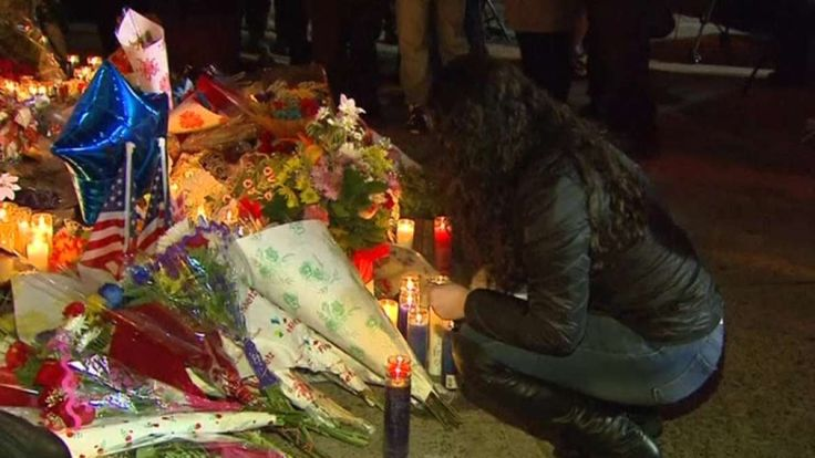 [video] New Yorkers honor slain police officers. New Yorkers hold a candlelight vigil in honor of two police officers who were shot to death as they sat in a patrol car in broad daylight. Vanessa Johnston reports.