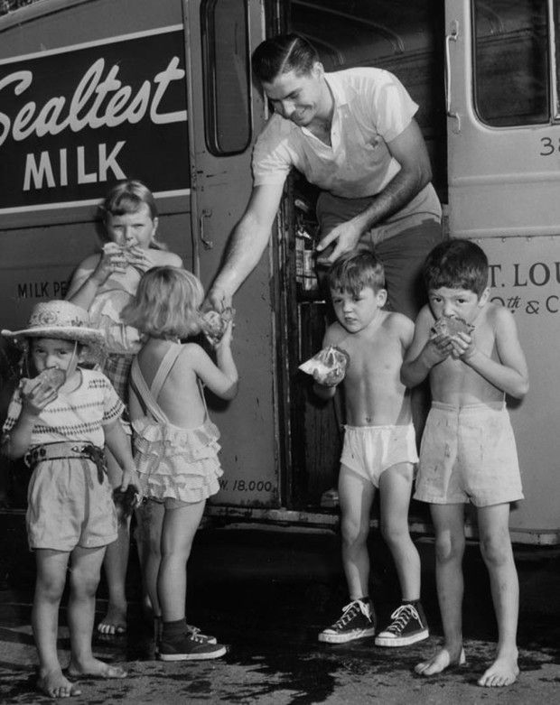 A kind milkman...1954--As the temperature reaches 109.3 degrees, St. Louis Dairy route man Kenneth Hogan proves a good neighbor, handing out big chips of ice to children.