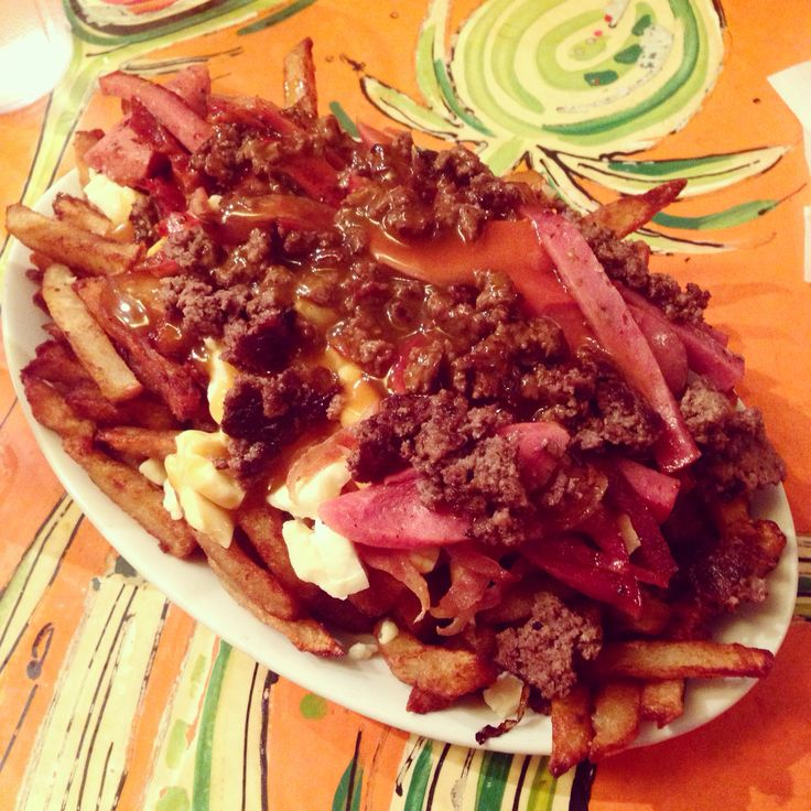 La Banquise: can't get better poutine then heading here. This massive poutine is filled with French fries, cheese, gravy, hot dogs, grinded meat, bacon. Quite the late night snack or dinner. It's called the TREX. They have a lot of make it your own Poutines