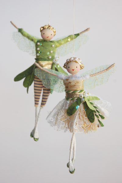 Halinka's fairies  MISTLETOE FAIRIES Designed and handmade by Halinka the Mistletoe fairies are ready for a Christmas kiss!The girl has a gold under skirt with an overlay of ivory lace. The boy is in similar colours with his striped trousers and mistletoe tail coat. Both have pearly mistletoe berries as decoration!They measure 12 to 13cm tall and arrive together in their gift box.
