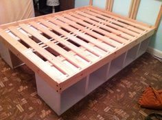 DIY storage bed... I would love this for all our bedrooms!!  (And an added bonus would that I wouldn't have to constantly crawl under the bed to retrieve dog toys that rolled under it!! Lol) Well Done!