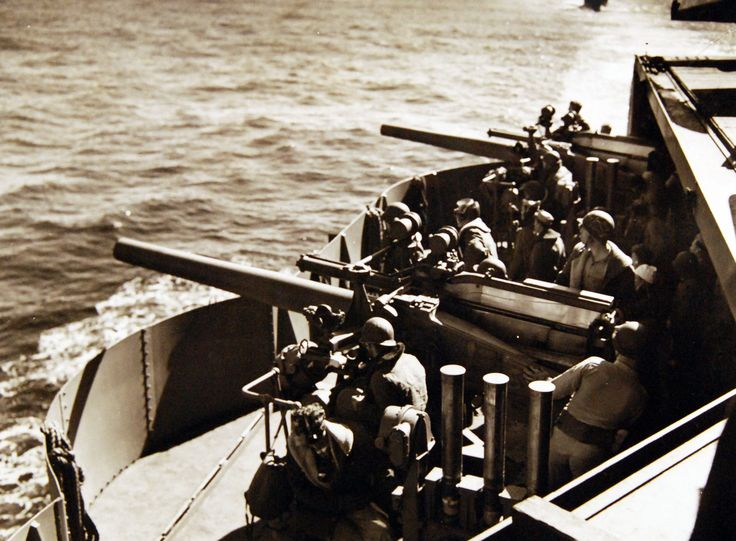"Operation Torch, November 1942. Gunnery, 40mm guns, during the U.S. Campaign in North Africa. Gun crews on an aircraft carrier after an ""alert"" has been sounded on the way to North Africa. Official U.S. Navy Photograph, now in the collections of the National Archives."