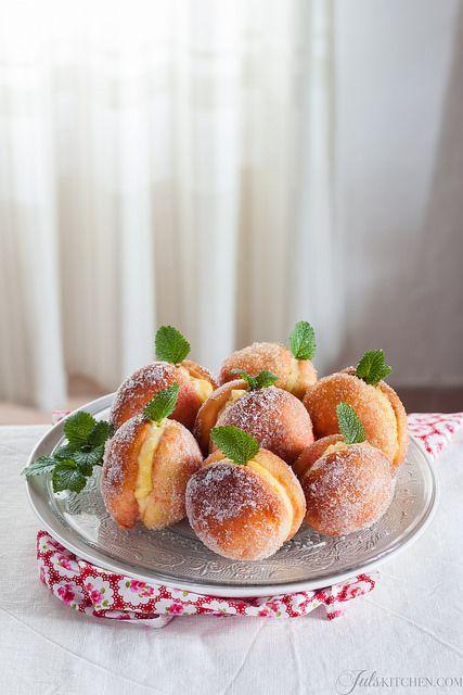 a special Tuscan sweet brioche known as Pesche di Prato, literally peaches of Prato.