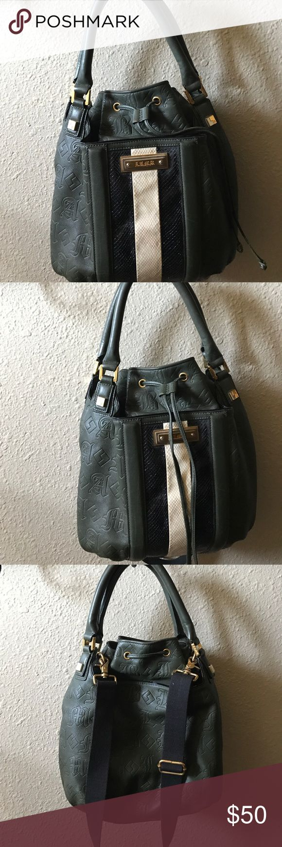 Handbag Bucket bag, olive green with black and cream, on the front . Lamb Bags