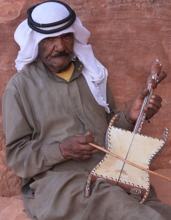 Jordan -Wadi Rum Bedouin playing the instrument called Rabab