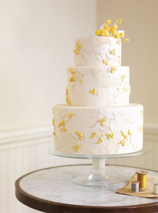 Yellow and White. Really cute...but it looks like impressions of croissants all over the cake...