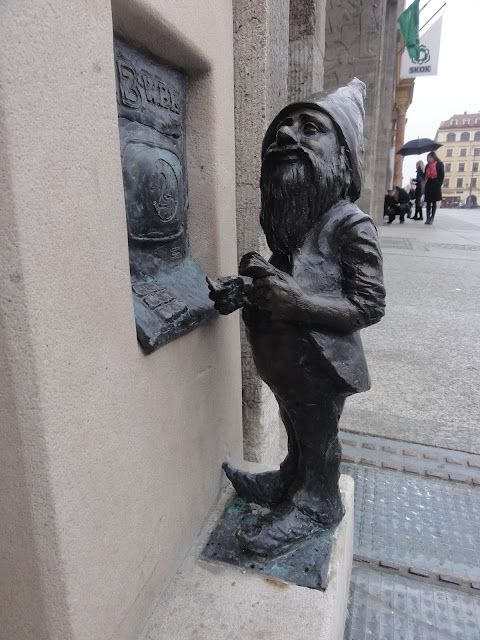 Tiny gnome statues appear everywhere in Wroclaw, Poland. Every major attraction, old back street and even shopping mall has a dwarf, each with a name. This one withdraws money at a tiny ATM.