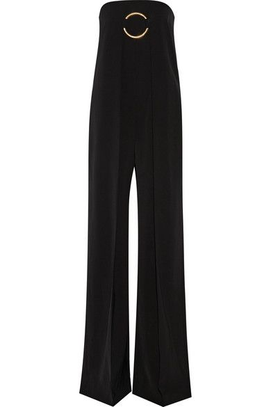 Every woman should have at least one of Stella McCartney's perfectly cut jumpsuits at her disposal. This latest version is cut from fluid black wool-twill and is punctuated with an oversized gold-tone ring. It's pleated through the wide leg for a flattering and elongating effect. Wear yours for evening with sandals and minimal accessories. Shop it now at NET-A-PORTER #StellaMcCartney