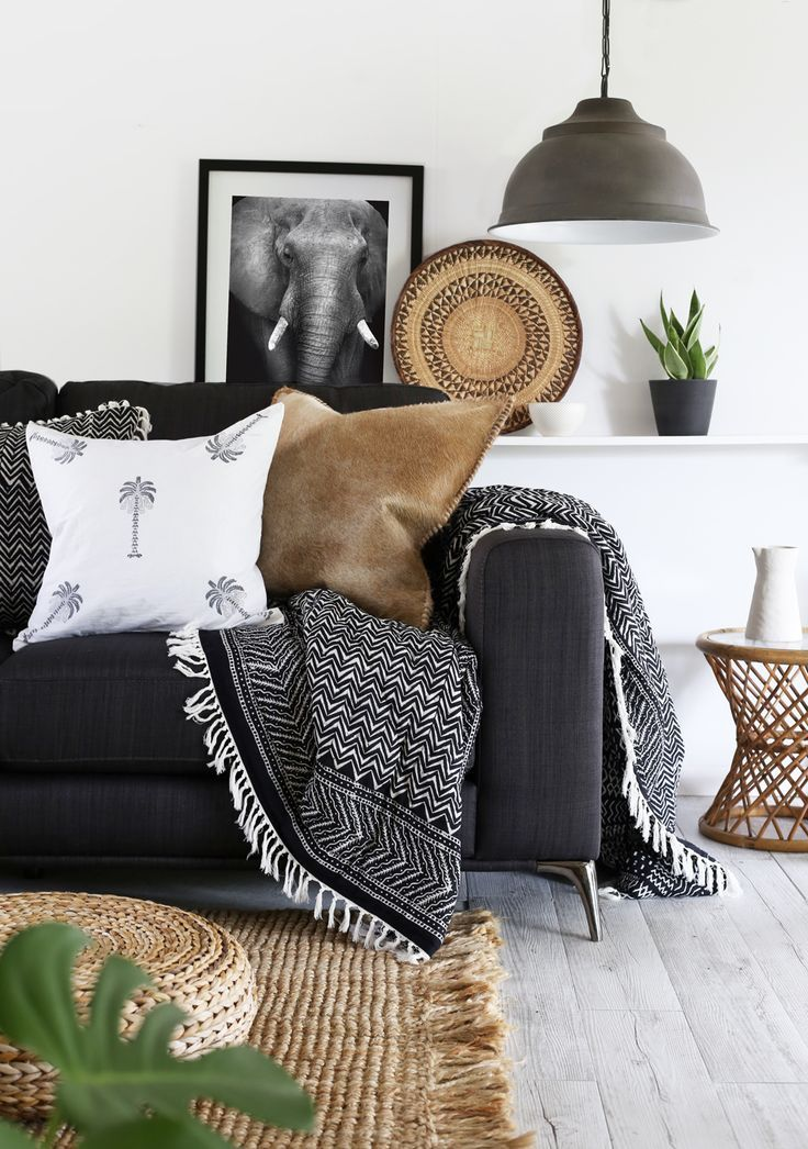 Paisley Thirteen LR black and white with neutral tones brought in with natural weaving.  We sell baskets like that!