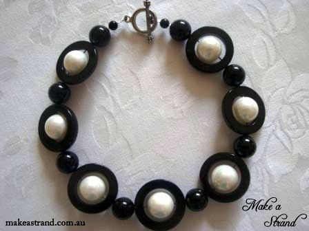 Black agate circles and large round beads contrast with large white shell pearls in this geometric, Mod-inspired choker (NB: small size) In stock: AU$130 + postage Click image to purchase.