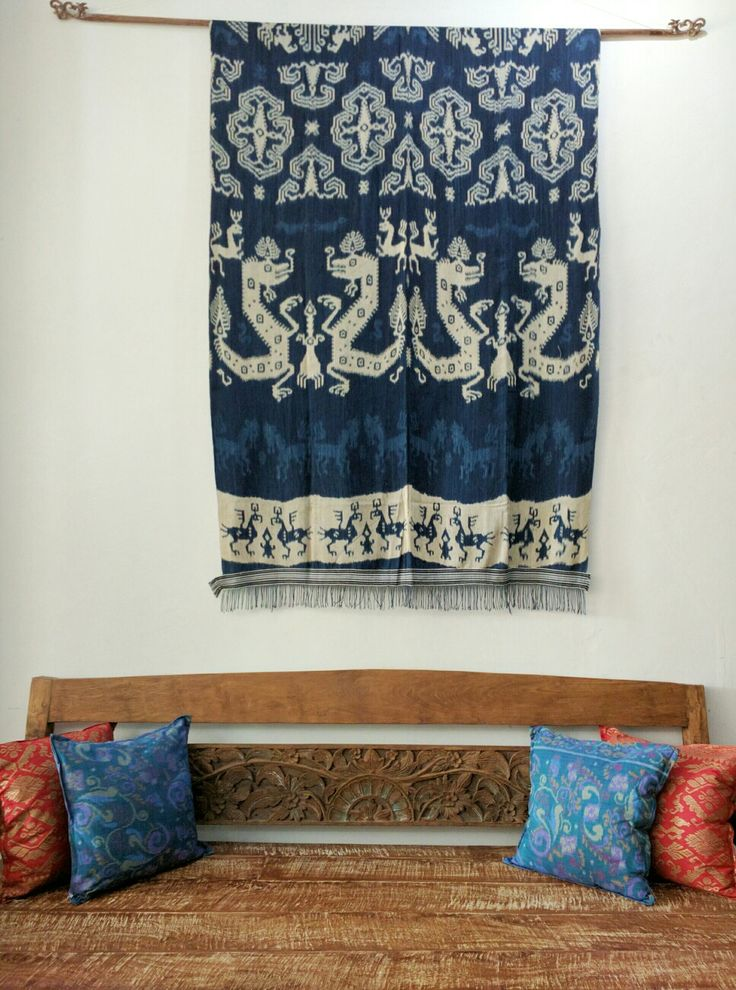 Sumba Indigo ikat hinggi with one of our old sofas. Local Balinese endek fabric make great accent cushions. www.kulukgallery .com