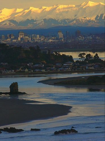 View from Sumner, back towards the city, with the Southern Alps in the background. Christchurch, New Zealand