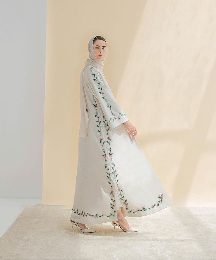 The kape #eidcollection2016 l florals and beading on white suiting fabric make for a #contemporary abaya