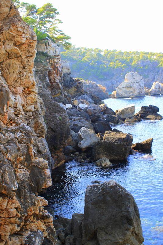 Cala De Deia, Mallorca. Full album @ artsyadventuress.com and photos at instagram.com/artsyadventuress #Mallorca # Travels # Photography #ocean #sea #Mediterranean #clearwater #bluewater #water #28mm #canon #caladedeia #deia #island #swim #snorkel #mountains #explore #adventure #beach #hike #cliff #serradetramuntana #beautiful #inspiring #wanderlust