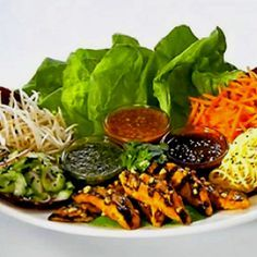 Thai Lettuce Wraps: Cheesecake Factory Satay Chicken Strips, Carrots, Bean Sprouts, Coconut Curry Noodles and Lettuce Leaves with three delicious Spicy Thai Sauces – Peanut, Sweet Red Chili and Tamarind-Cashew.