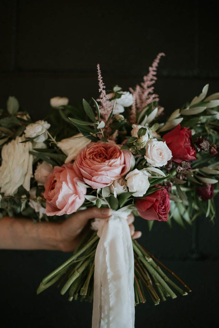 Pink wedding bouquet with silk white ribbon   Image by Olivia Strohm Photography