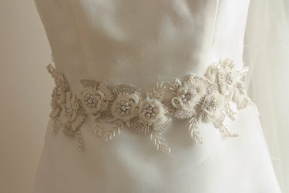 Bridal sashes and belts - Vintage flower ( 14 inches) Colors : Offwhite , ivory and silver Length = 14 inches Max width in the center is about 2.2 to 2.4 approximately. Finished with ivory ribbon on e