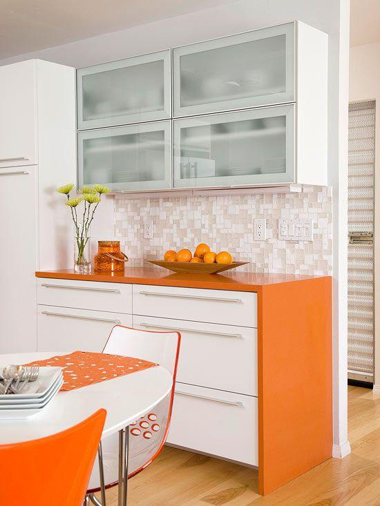 Striking Orange inspired by midcentury modern. Awesome glass backsplash.