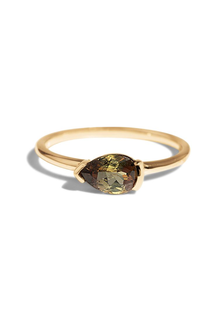 The Andalusite Nikko Engagement Ring has a horizontally prong set ethically sourced pear cut andalusite gemstone and is handmade in Philadelphia from reclaimed or fairmined precious metals. We go beyond conflict free to design handcrafted jewelry with a positive impact in mind.