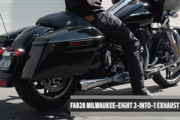 This 2010 custom Harley-Davidson Road Glide motorcycle looks villainous in flat black paint and owns the road with her power and reflexes.