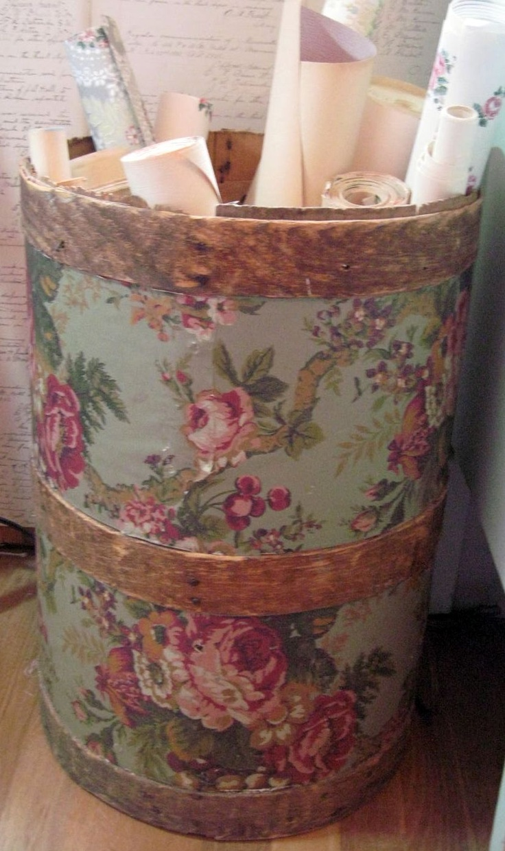 Wallpaper roses on recycled barrel..nice.  Great to store gift wrap too.