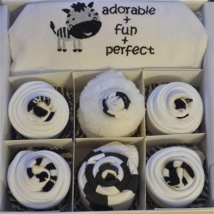 These dorable cupcakes are perfect for a little baby girl or baby boy and would also make an amazing Baby Shower gift. Zebra cupcake contents  x1 White gift box with zebra ribbon x1 Long sleeve bodysuit x1 Elasticated bottoms x1 Zebra hat x2 Pairs of socks x4 White Bibs x1 White wash cloth x1 Handmade gift card (Please insert message below)  All contents are 0-3 months in size