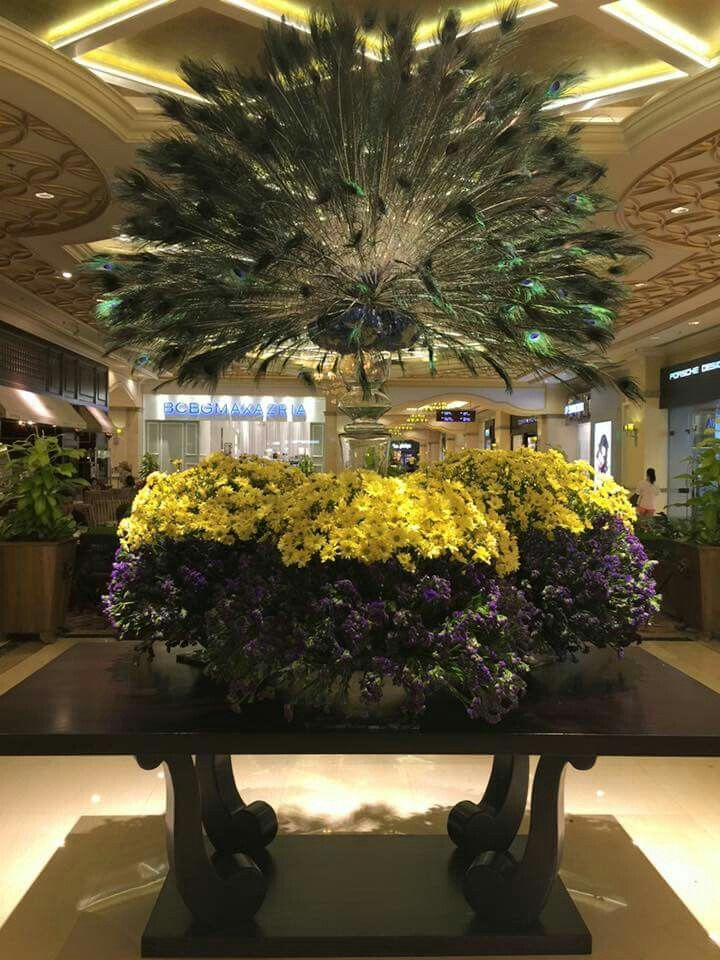 Beautiful peacock/flower display at Maxims Hotel, Resorts World Manila, Philippines #winstoneflowers #rwmanila #lobbyflowers #hotelflowers #resortsworldmanila #hotelflorist