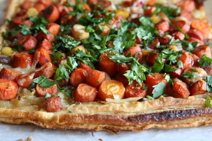 Caramelized Carrot and Onion Tart:  A tart is the perfect side dish since it's super easy to make but just so happens to look extremely swanky. Impress your guests with a delicious combination of caramelized carrots and onions for a side that they won't mind eating over the main course. - Delish.com