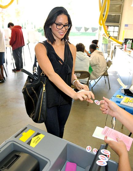 """Olivia Munn received an """"I Voted"""" sticker at a polling station in L.A. Nov. 6"""