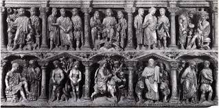 Sarcofago di Giunio Basso, datato circa nel 359 d. C. scultura in marmo che si trova nella città del Vaticano. Scolpito nel bel marmo di Atene rappresenta alcune scene cristiane. Le colonne sono false e non c'è proporzionalità. per la prima volta vediamo rappresentati Adamo ed Eva e Cristo seduto sul trono insieme ai due maestri. è stato commissionato da un prefetto romano