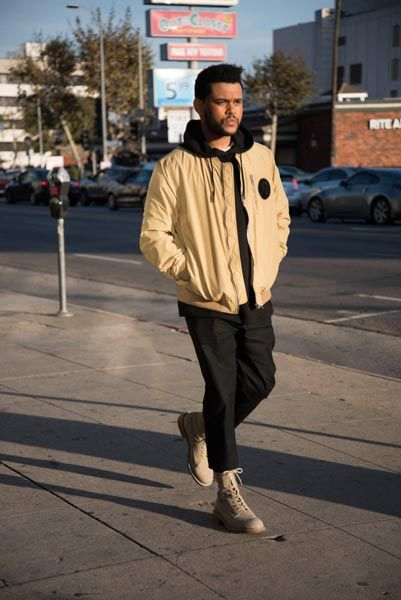 The Weeknd's selection of men's wear icons by H&M is branded with the musician's 'XO' streetwear label. fig.: Abel Tesfaye (aka The Weeknd) in gold-sand colored bomber jacket, trousers, and hoodie from the H&M collection 'Spring Icons Selected by The Weeknd', available from 2 March 2017.