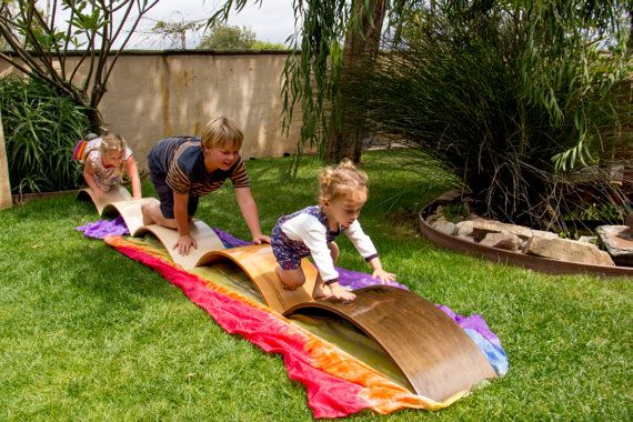 A Waldorf Inspired Creation. Curvy boards are teeter totters, balance beams, slides, and... anything else your child can dream up. This