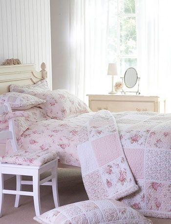 A traditional rustic bedroom is always effortlessly pretty. Lovely patchwork quilts in pretty pink fabrics will give any room an instant cottage style. Elisha quilt by Coast & Country.