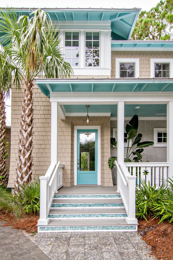 Coastal exterior, blue front door, glass tile on stairs, tan siding | Glenn Layton Homes
