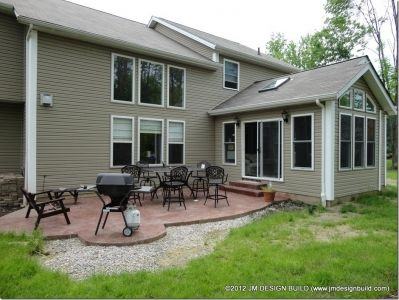 Sunroom Addition Twinsburg OH Stamped Concrete Patio off of the Sunroom thats perfect for