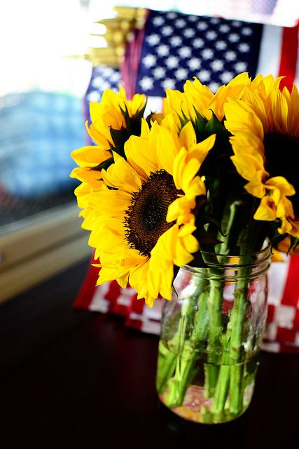 Awesome fourth of July combo!  Sunflowers and American Flags! Whats more american?  Ree Drummond / The Pioneer Woman