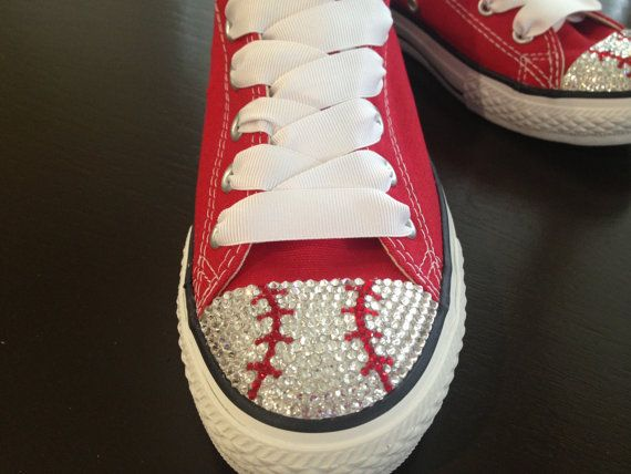 The more that I see these the more I want a pair. Wonder how hard to make my own. Baseball or Softball Swaroski Blinged Converse by TeamMomBling