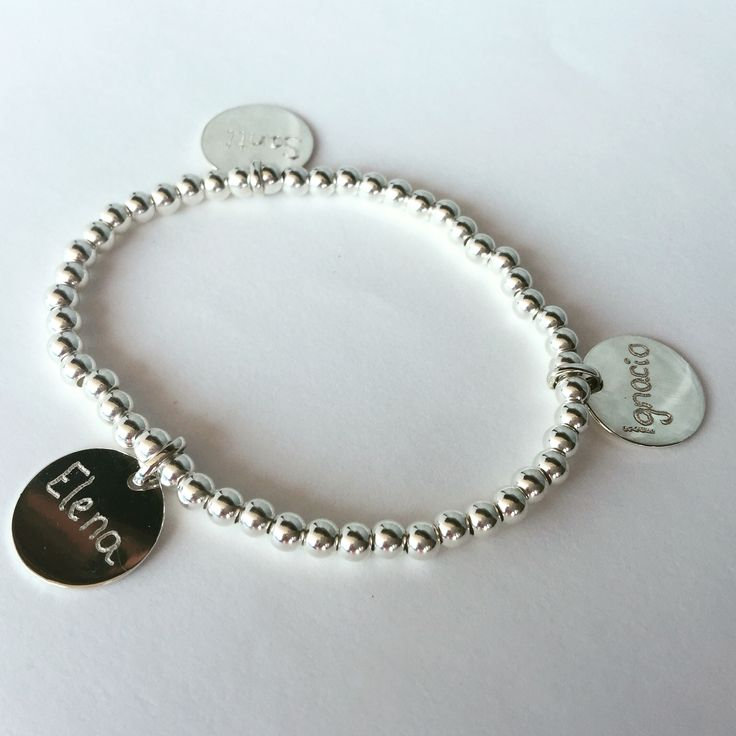 Engraved silver bracelet with names in medals.