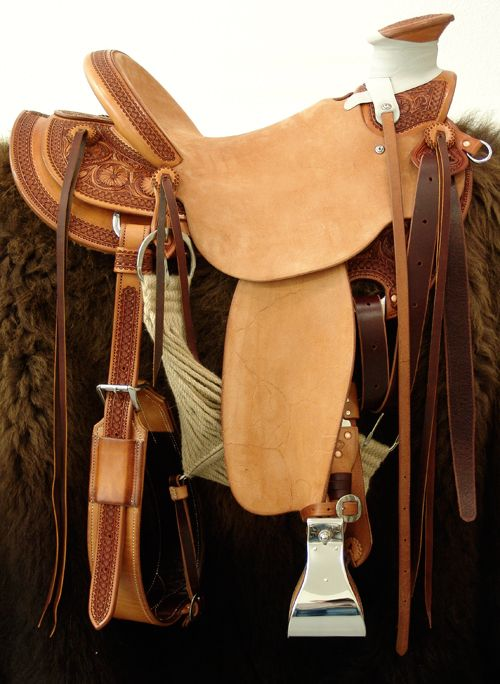 8 & 1/2 Half Breed Wade Saddle by Keith Valley   Specs: Wade tree by Rick Reed 16 inch seat Gullet - 7 & 1/2H by 6 & 1/4W by 4 94 Degree Bars Horn - 3 & 5/8ths high by 4 & 1/2 Guatelajara Cantle - 4&1/2 inches high by 12&1/2 inches wide Cheyenne Roll - 1 & 3/4 inches 7/8ths flat plate riggin Vaquero Geometric Border with Sheridan Style Floral Stainless Steel Hardware - by Harwood 4&1/2 inch Monel Stirrups Santa Barbara twisted stirrup leathers Full length stirrup leathers 32 inch 100% Mohair…