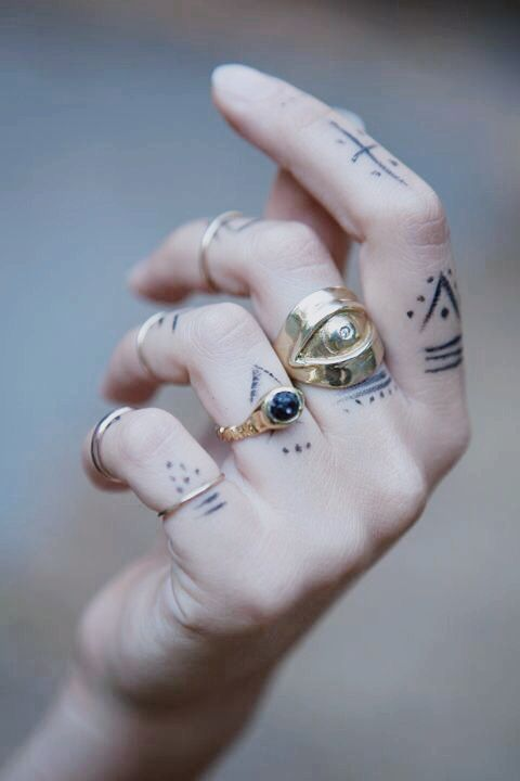 rings and tattoos. although the 'tattoos' appear to be drawn on with pen...