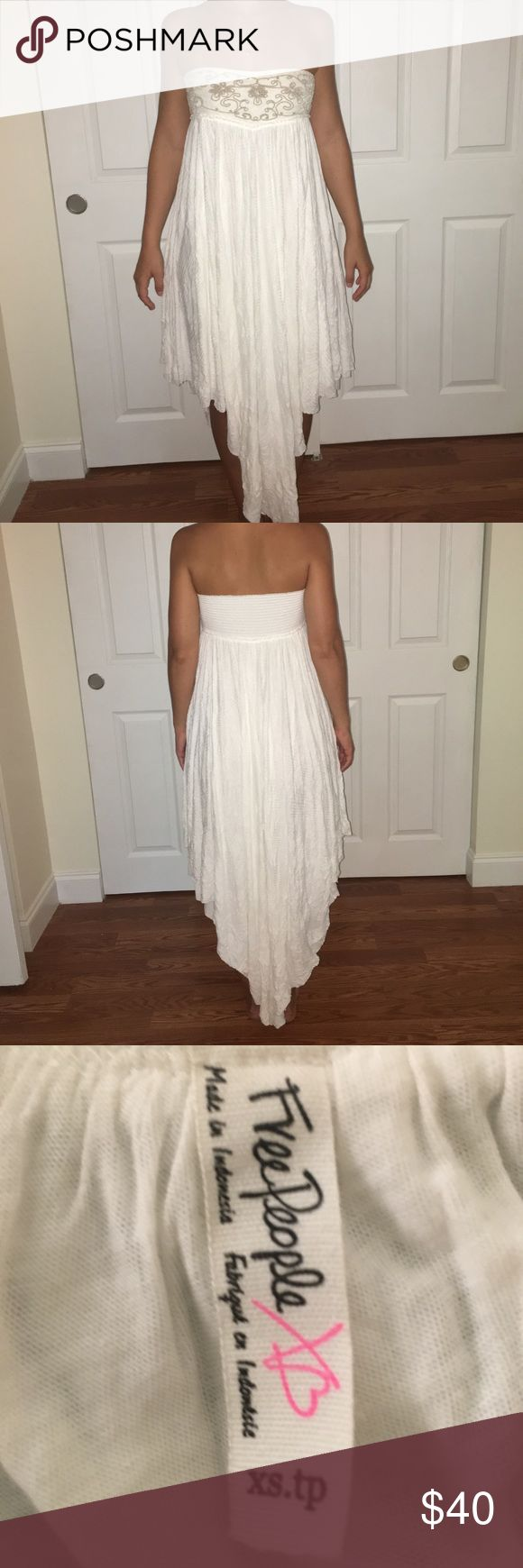 Free people white dress Beautiful gauzy white dress. Strapless and has brown cord embroidery on the bust line. Free People Dresses