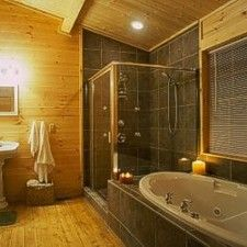 I love the wood on the walls and ceilings. Two person shower plus whirpool tub. :)