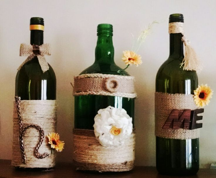 item used:  1- jute cloth piece and twine  2- old vine bottles  3- leather strip for making alphabet H  4- hand made flower or use artificial flowers (like I did) 5- of course, a glue gun (life saver) and voila!!