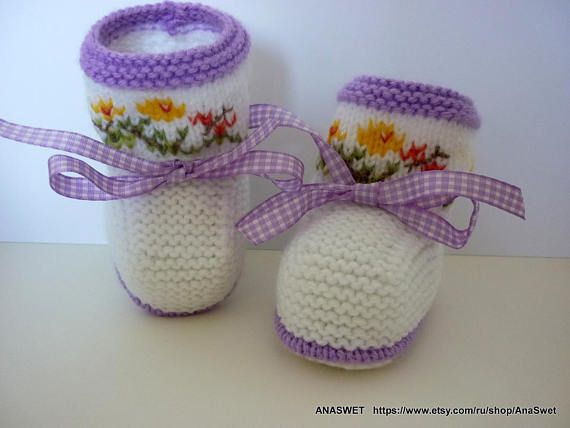 Colorful knitted baby booties/slippers/shoes with a purple