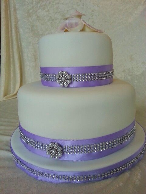 Elegant diamonds with purple and white wedding cake.