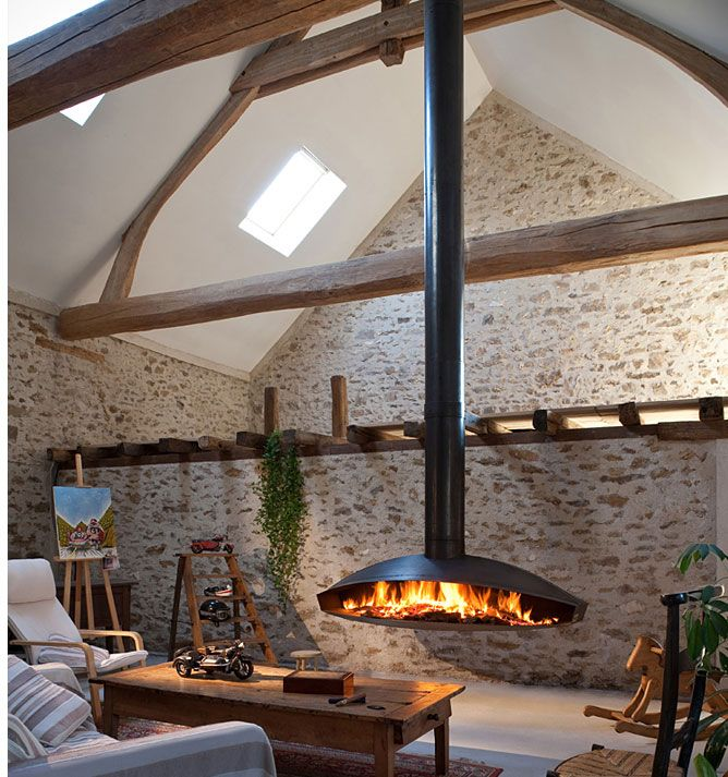 A Very Comfortable Living Space With Fantastic Sky Lights, Exposed Beams On  Vaulted Ceilings, Subtle Stone Walls Throughout And The Centerpiece Of The  Room: ...