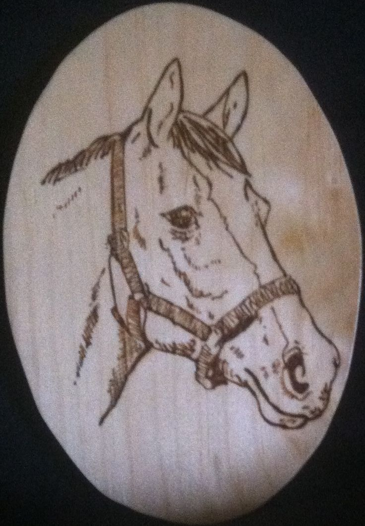 """Handmade* hand burnt Horse wood burning. Burnt on an oval piece of pine wood with a polyurethane finish, and also has a gold-tone saw-tooth hanger attached. Dimensions ~ 6.625 x 4.625 x .75"""" *All are"""