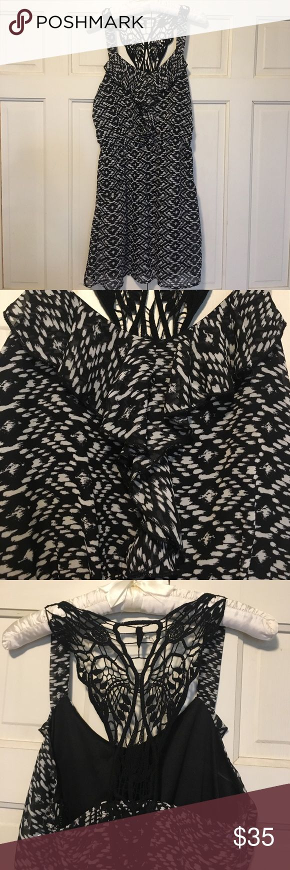 💜 Flirty spring dress Black and white summer dress with crochet t-back. Dress has sheer overlay with black lining underneath. Worn once for a summer wedding. Hand washed. No smoking home. Speechless Dresses