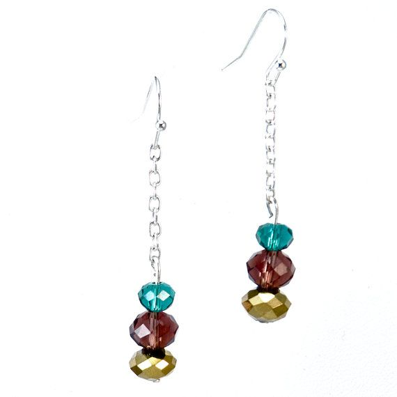 PEACOCK EARRINGS Beautiful Rondelle Swarovski Crystals in Blue Zircon, Burgundy and Dorado tones elegantly hung on a sterling silver rolo chain. These earrings have a beautiful movement and are light as a feather. *Custom Orders Available*  CA $24.95 http://pursuademe.com/shop/?id=38